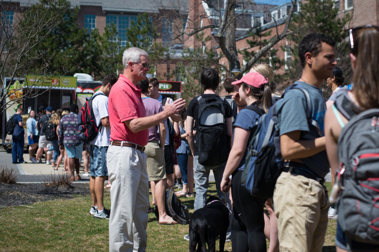 UNH President Mark Huddleston greeting students.