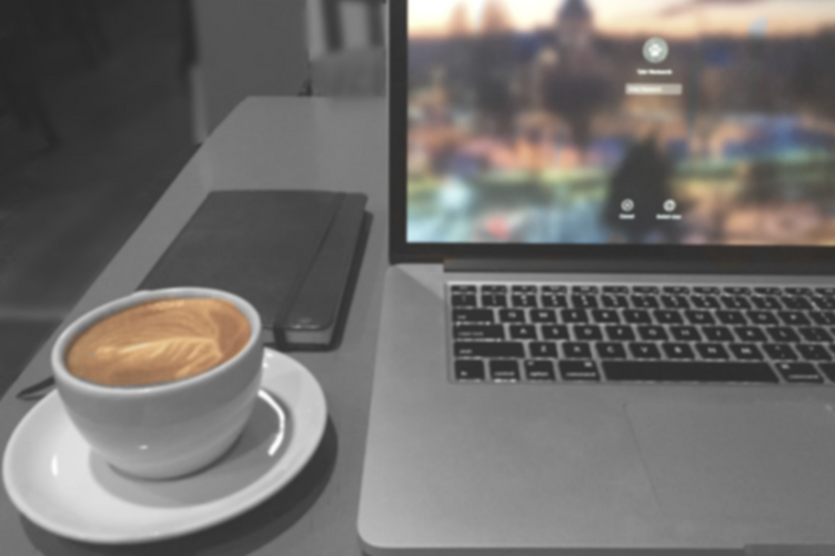 computer and cup of coffee
