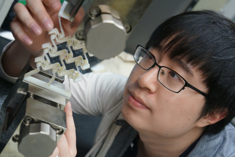 Yunyao Jiang, a doctoral candidate in mechanical engineering at UNH, using a 3D-printed prototype to prove concept of sequential cell-opening mechanism.