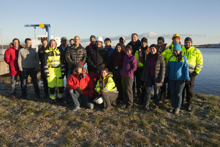 Large group of hydrographers at the edge of the ocean