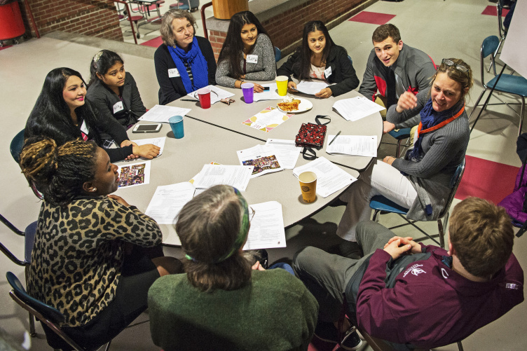 Image of a group conversation during a round table discussion.