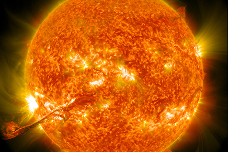 Close-up illustration of the sun with eruptions occurring on its surface.