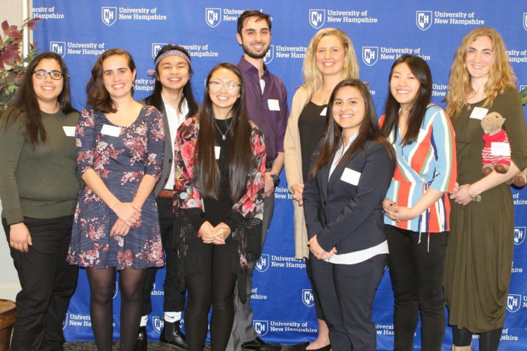 A group of students post for a photo at the CYOS luncheon