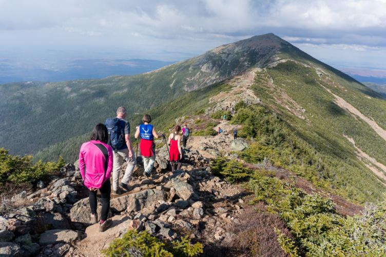 People hiking along mountain ridge