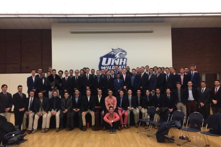 All of the members of TKE lined up in the Strafford Room at UNH