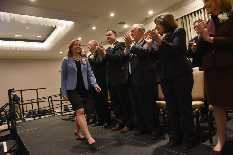 Mayor Craig walks past the three previous mayors of Manchester at her inauguration on January 2.