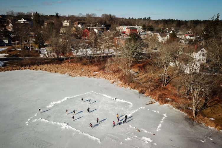 UNH students skating on the Mill Pond