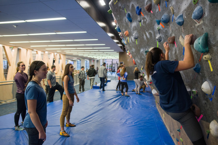 UNH students at the campus bouldering wall