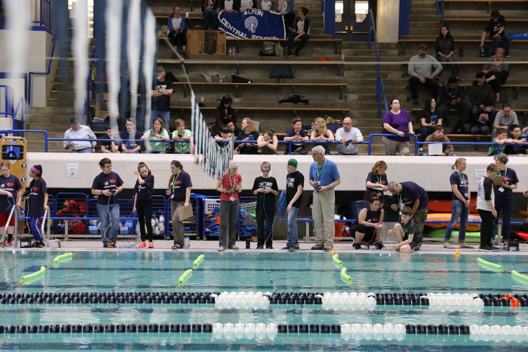 Middle school students driving robots at University of New Hampshire pool during SeaPerch event