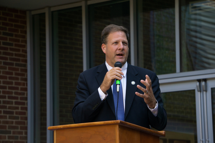 New Hampshire Governor Chris Sununu speaking at the closing ceremonies for a UNH summer all-girls STEM camp