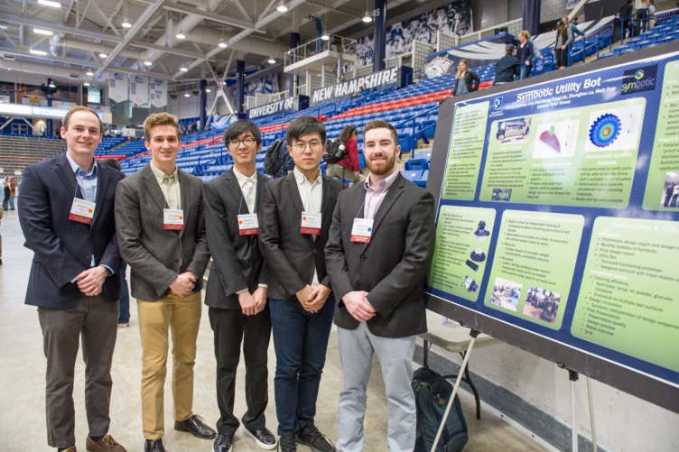 Five CEPS students standing beside a poster at URC