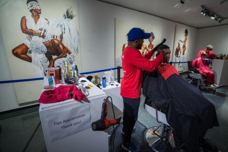 UNH community members getting free haircuts