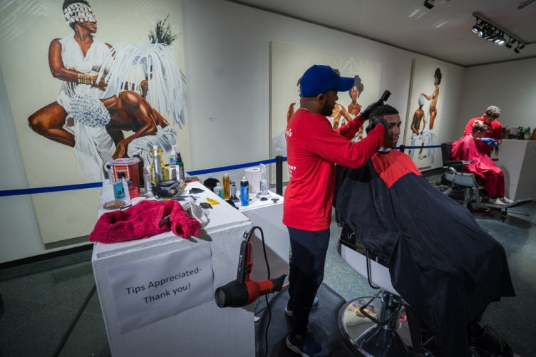 UNH community members getting free haircuts