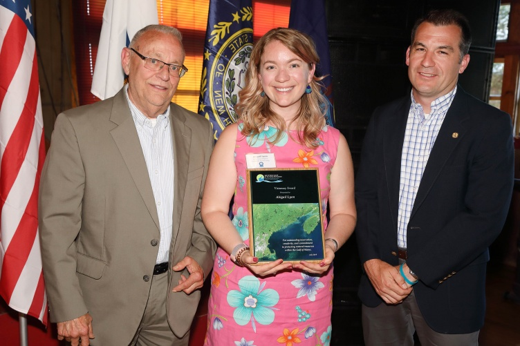 Abigail Lyon receives award plaque from Gulf of Maine Council.