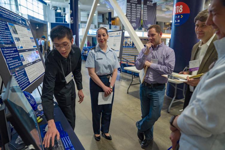 Jason Nguyen and Veronica Chambers-O'Bryan present smartphone info at URC