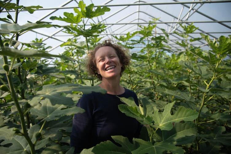 Becky Sideman in a field of plants