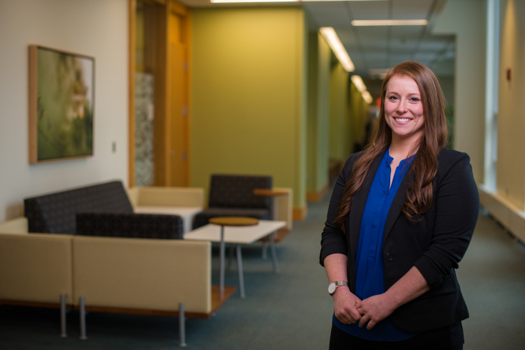 Assistant Professor of Organizational Behavior and Management Jennifer Griffith standing in a hallway of Paul College
