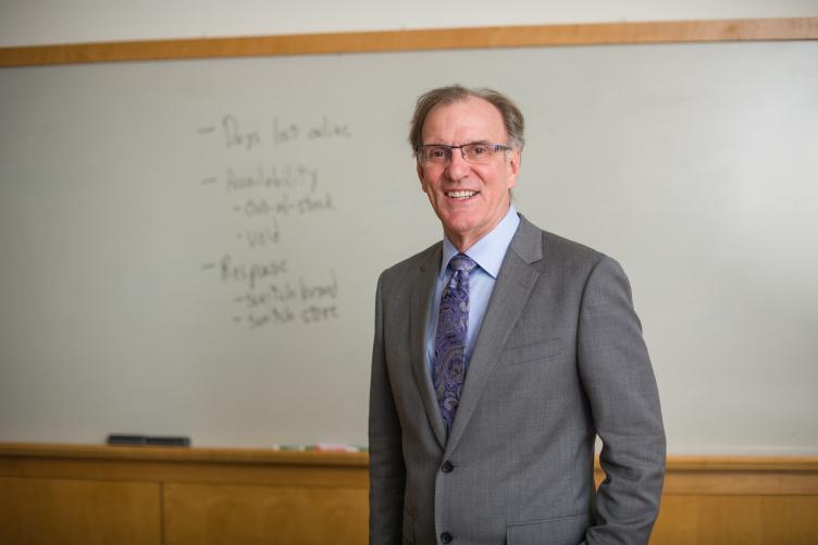 Marketing professor Tom Gruen poses in front of a white board