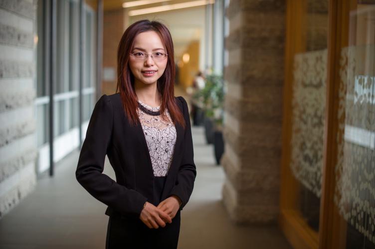 Assistant Professor of Finance Zhaozhao He posing in hallway