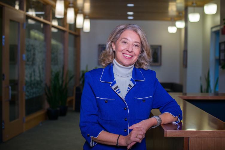 Associate Professor of Hospitality Management and Fulbright Scholar Valentini Kalargyrou poses in hallway
