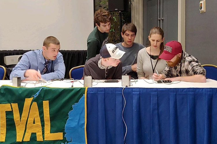 students conferring in geography bowl