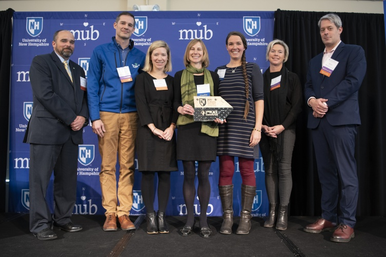 Jessica Forrest (fourth from left) and Hannah MacBride (third from right) with judges from the NH Social Venture Innovation Challenge.