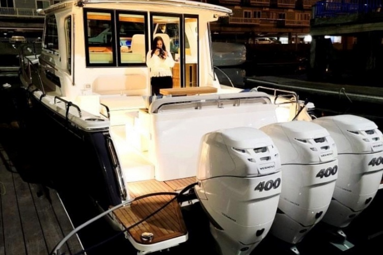 Abigail Chamberlain '20 takes photos of a yacht for her job as operations coordinator for Alfred's Upholstery