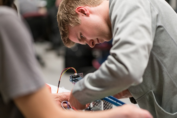 Engineering technology student studies control systems design in the lab at UNH Manchester