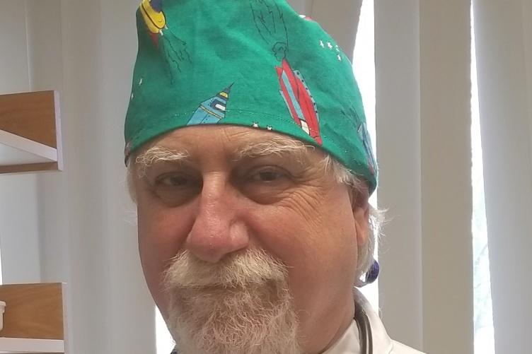 Glenn Homman '77 dressed in scrubs