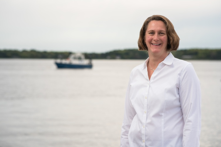 Portrait of marine researcher Jennifer Miksis-Olds with ocean in background