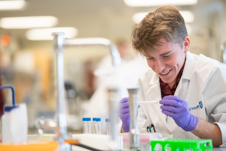 Thomas Gerton '23, biotechnology major, works in the lab at UNH Manchester