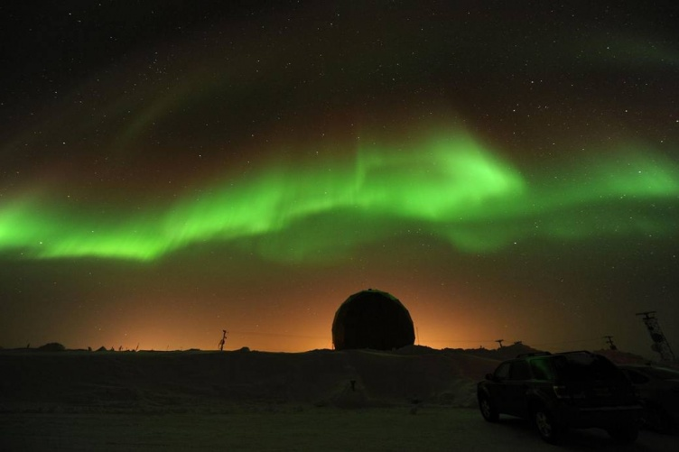 Northern Lights dance across the night sky