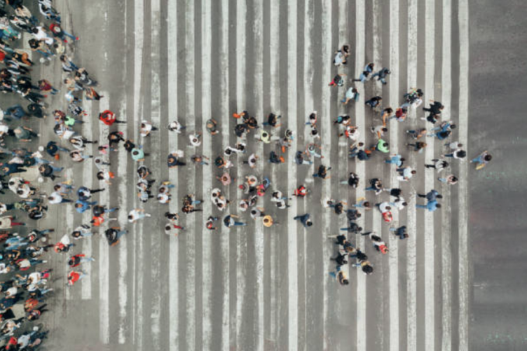Image of people crossing the street in the form of an arrow