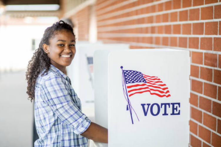 Young girl voting in America