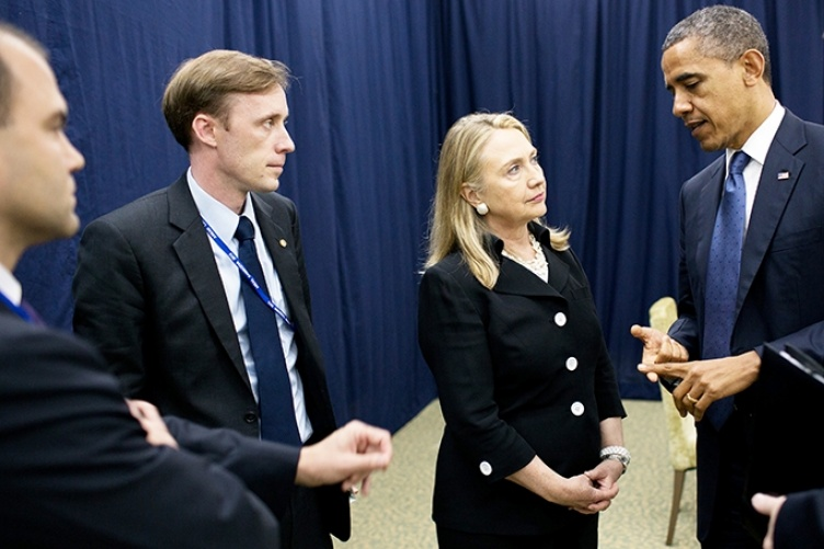 Jake Sullivan stands with former President Barak Obama and former Secretary of State Hillary Clinton