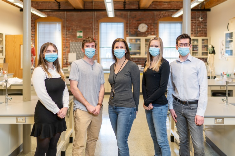 Professor Sue Cooke and four UNH Manchester students who make up Team Cooke