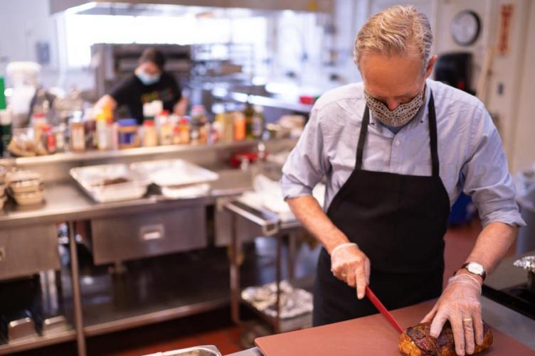 Dave Mortensen prepares meatloaf meals.