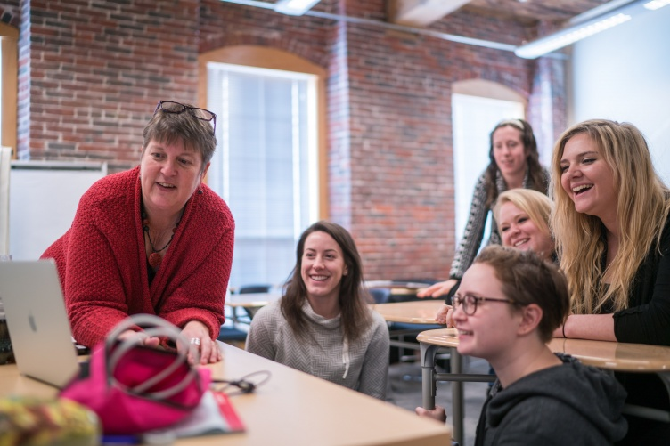 Laurie Shaffer, lecturer of ASL/English interpreting at UNH Manchester, working with students