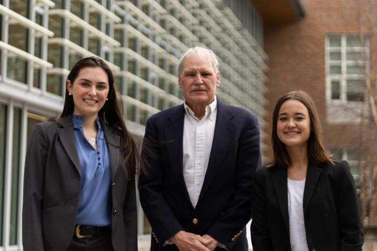 UNH Paul College students Aidan Kittredge and Kelsie Dawe with Professor Jeffrey Sohl