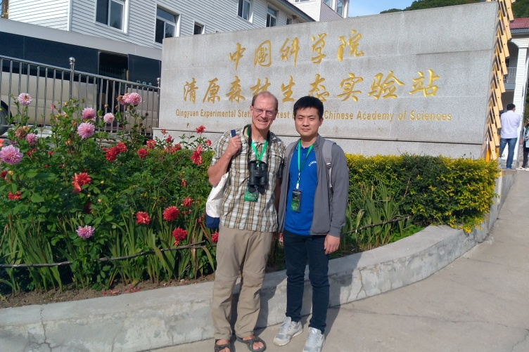 Erik Hobbie stands with a colleague at the Qingyuan Experimental Station in China.