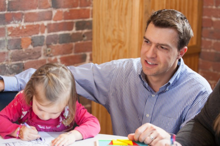 Psychology professor Nicholas Mian working with a child in the child psychology lab at UNH Manchester
