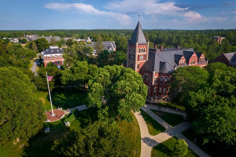 Aerial shot of UNH campus in summer, with T Hall in center