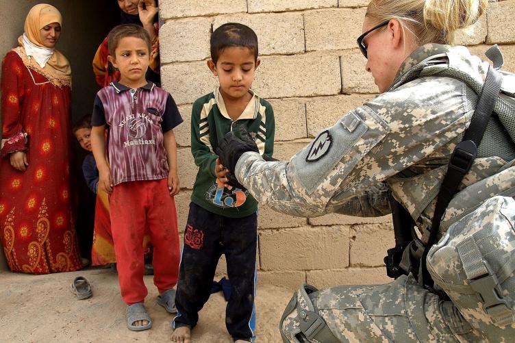 soldier greeting children