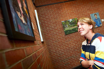 student viewing artwork in philbrook dining hall