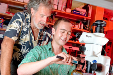 win watson with student at microscope