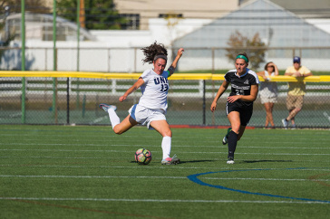UNH women's soccer player Brooke Murphy about to kick the ball