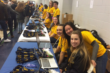 students manning registration table at HYPE