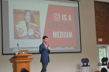 A speaker presents at the 2018 Paul College Digital Marketing Symposium