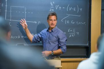 Professor Ben Chandran at chalkboard