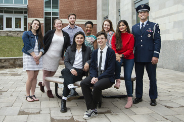 group photo of nine student ambassadors outside academic building